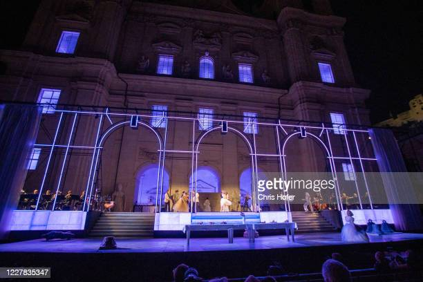 """Actors performing on stage during the outdoor TV and press rehearsal of the production """"Jedermann"""" at Domplatz on July 29, 2020 in Salzburg, Austria...."""