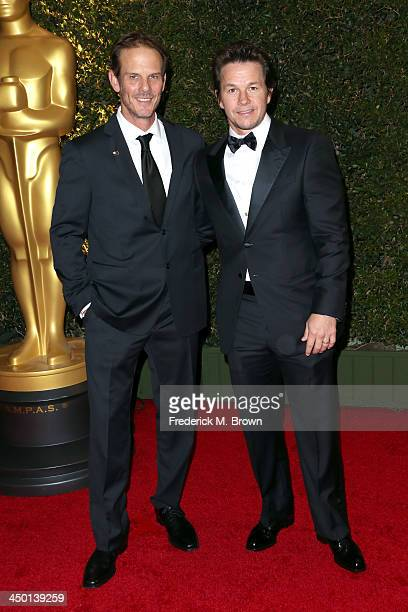 Actors Peter Berg and Mark Wahlberg arrive at the Academy of Motion Picture Arts and Sciences' Governors Awards at The Ray Dolby Ballroom at...