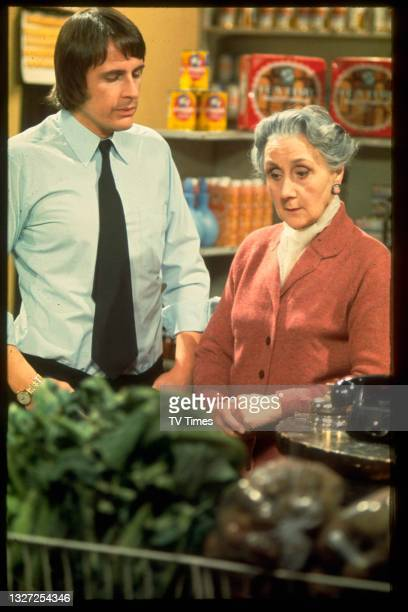 Actors Peter Brooks and Elisabeth Croft in character as Vince Parker and Miss Tatum in television soap Crossroads, circa 1975.