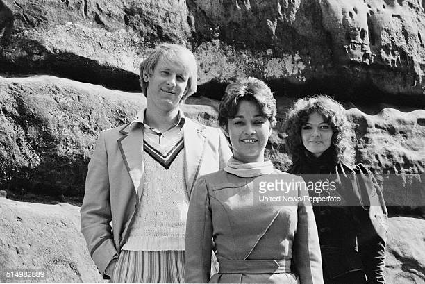 Actors Peter Davison Janet Fielding and Sarah Sutton pictured together in character as The Doctor Tegan Jovanka and Nyssa on the set of the BBC...