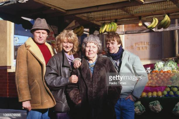 Actors Peter Dean Gillian Taylforth Anna Wing and Adam Woodyatt pictured on the exterior set of the BBC soap opera 'EastEnders' November 21st 1984