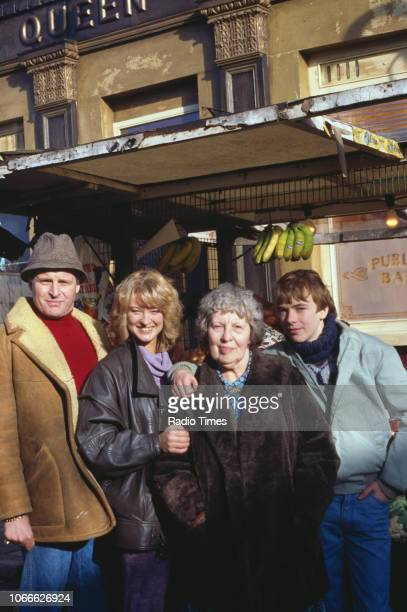 Actors Peter Dean Gillian Taylforth Anna Wing and Adam Woodyatt pictured on the exterior set of the BBC soap opera 'EastEnders' September 26th 1986