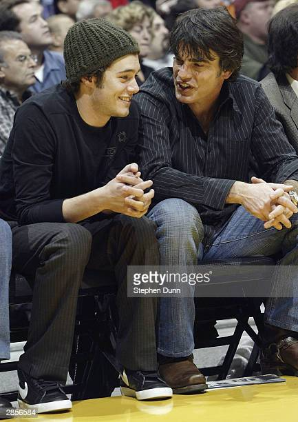 Actors Peter Gallagher and Adam Brody from the television series The OC chat while attending the game between the Los Angeles Lakers and the Atlanta...