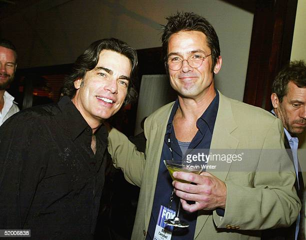 Actors Peter Gallagher and Bill Campbell at the 'White Hot Winter on Fox' TCA Party at Meson G on January 17 2005 in Los Angeles California
