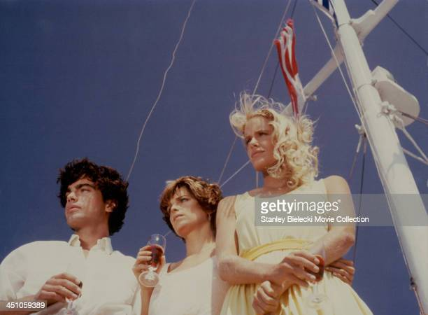 Actors Peter Gallagher Daryl Hannah and Valerie Quennessen in a scene from the movie 'Summer Lovers' 1982