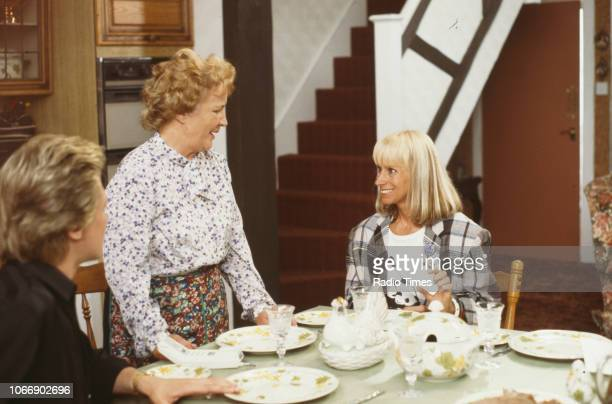 Actors Peter Howitt Jean Boht and Rita Tushingham in a kitchen scene from the BBC television sitcom 'Bread' August 21st 1988
