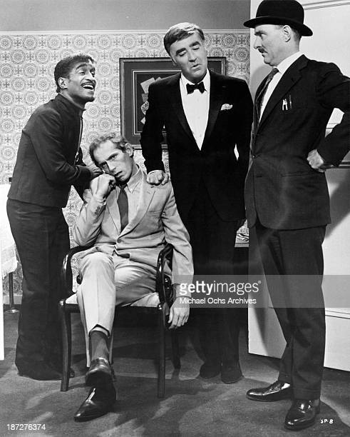 Actors Peter Lawford Sammy Davis Jr and Michael Bates on set of the movie Salt and Pepper in 1968
