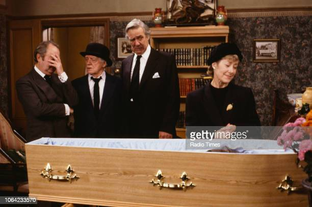 Actors Peter Sallis Bill Owen Michael Aldridge and Josie Kidd in a funeral scene from episode 'The Day of the Welsh Ferret' of the BBC television...