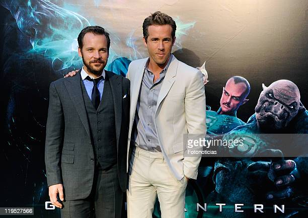 Actors Peter Sarsgaard and Ryan Reynolds attend the premiere of Green Lantern at Callao Cinema on July 21 2011 in Madrid Spain