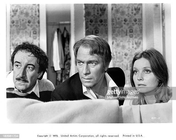 Actors Peter Sellers and Christopher Plummer with actress Catherine Schell on set of the United Artists movie The Return of the Pink Panther in 1975