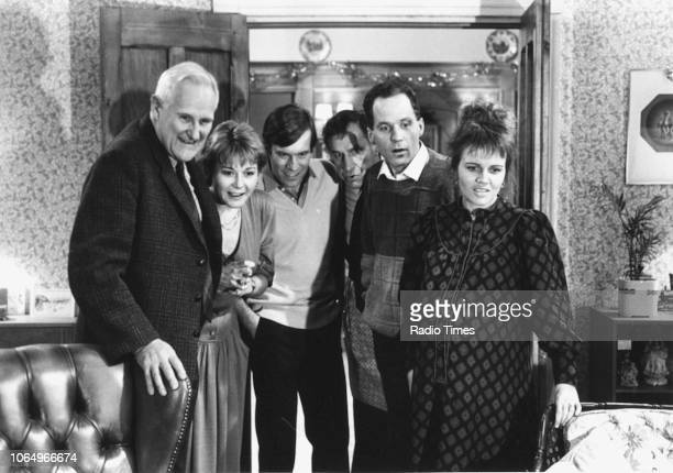 Actors Peter Vaughan Barbara Flynn Vicky Henson Geoffrey Palmer Michael Cashman and Leslie Dunlop in a scene from the BBC television play 'Season's...