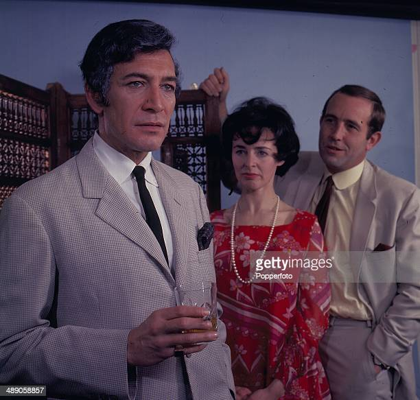 Actors Peter Wyngarde and Ian Hendry on right with actress Jeanette Sterke in a scene from the television play 'The Crossfire' in 1967