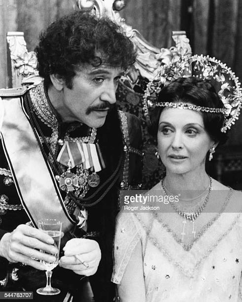 Actors Peter Wyngarde and Nyree Dawn Porter in costume during rehearsals for the play 'Anastasia' at the Cambridge Theatre London September 21st 1976