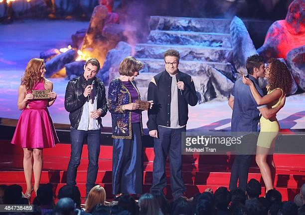 Actors Peyton McCormick Dave Franco Sandra Daubert Seth Rogen Zac Efron and Tiffany Luce speak onstage during the 2014 MTV Movie Awards held at Nokia...