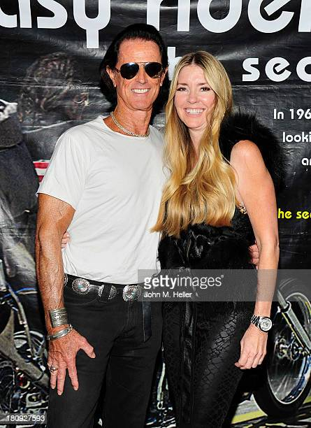 Actors Phil Pitzer and Jodie Fisher attend the premiere of 'Easy Rider The Ride Back' RideIn at Bartels' HarleyDavidson on September 17 2013 in...