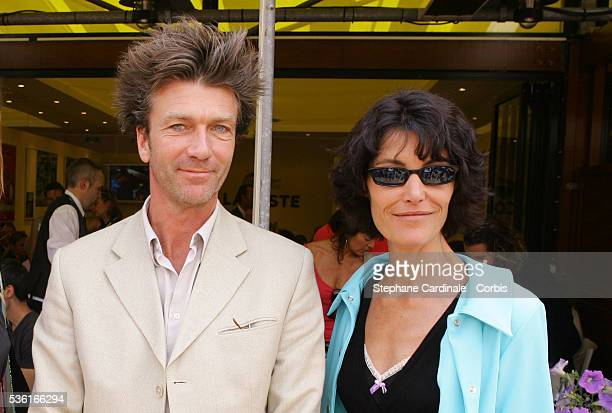 Actors Philippe Caroit and Caroline Tresca attend the Lacoste Lunch at Roland Garros village during the 2004 French Open Tennis tournament.