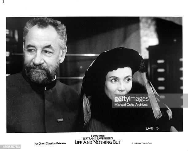 """Actors Philippe Noiret and actress Sabine Azema on set of the movie """" Life and Nothing But """" , circa 1989."""