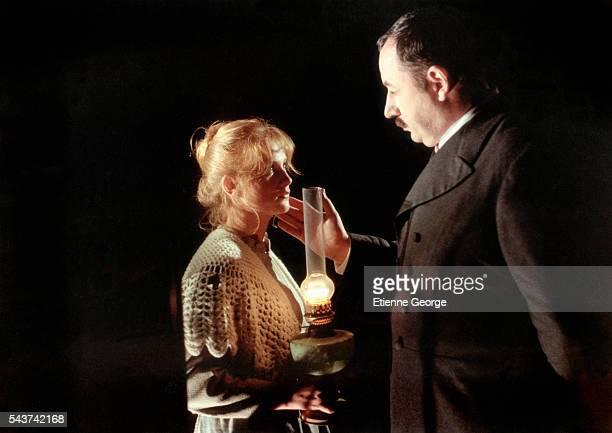 Actors Philippe Noiret and Isabelle Huppert on the set of 'Le Juge et l'Assassin' directed by Bertrand Tavernier Michel Galabru won the 1977 'Best...