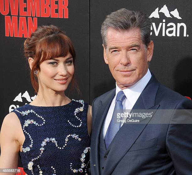 Actors Pierce Brosnan and Olga Kurylenko arrive at the Los Angeles premiere of 'The November Man' at TCL Chinese Theatre on August 13 2014 in...