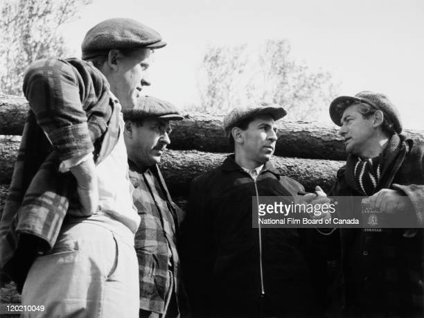Actors Pierre Dufresne Roland d'Amour Aimé Major and Felix Leclerc are having a discussion during a scene from the National Film Board of Canada's...