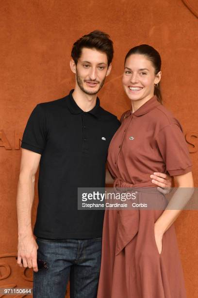 Actors Pierre Niney and Natasha Andrews attend the Men Final of the 2018 French Open Day Fithteen at Roland Garros on June 10 2018 in Paris France