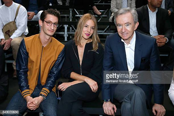 Actors Pierre Niney Natasha Andrews and Owner of LVMH Luxury Group Bernard Arnault attend the Dior Homme Menswear Spring/Summer 2017 show as part of...