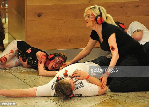 Actors play the part of casualties during a simulation of an attack by a suicide bomber inside a shopping centre in Manchester north west England on...