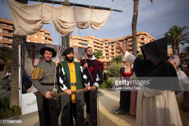Actors playing Juan Sebastian el Cano and Magallanes prepare to board a replica of the Spanish ship Nao Victoria the first Spanish ship to...