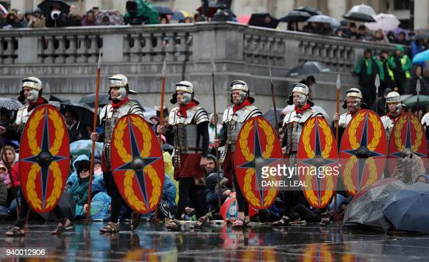 Actors playing Roman guards carry their shields during a performance of Wintershall's 'The Passion of Jesus' on Good Friday in Trafalgar Square in...