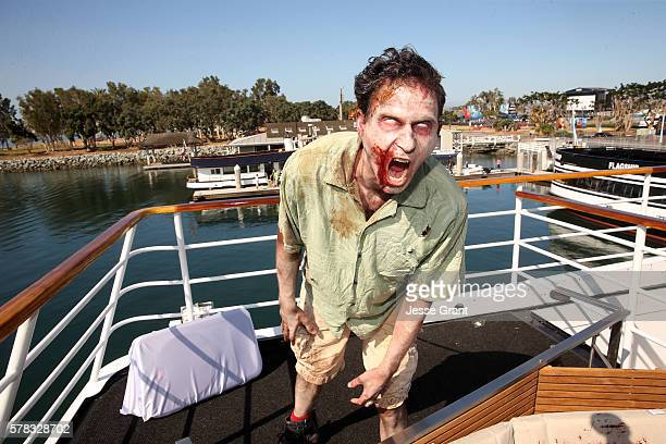 Actors playing zombies walk at the Fear the Walking Dead activation during San Diego ComicCon International 2016 at the Abigail boat on July 21 2016...