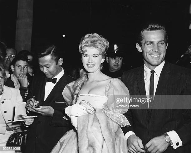 Actors Poncie Ponce Connie Stevens and Robert Conrad greeting fans as they arrive at the premiere of the movie 'Sunrise at Campobello' at the Beverly...