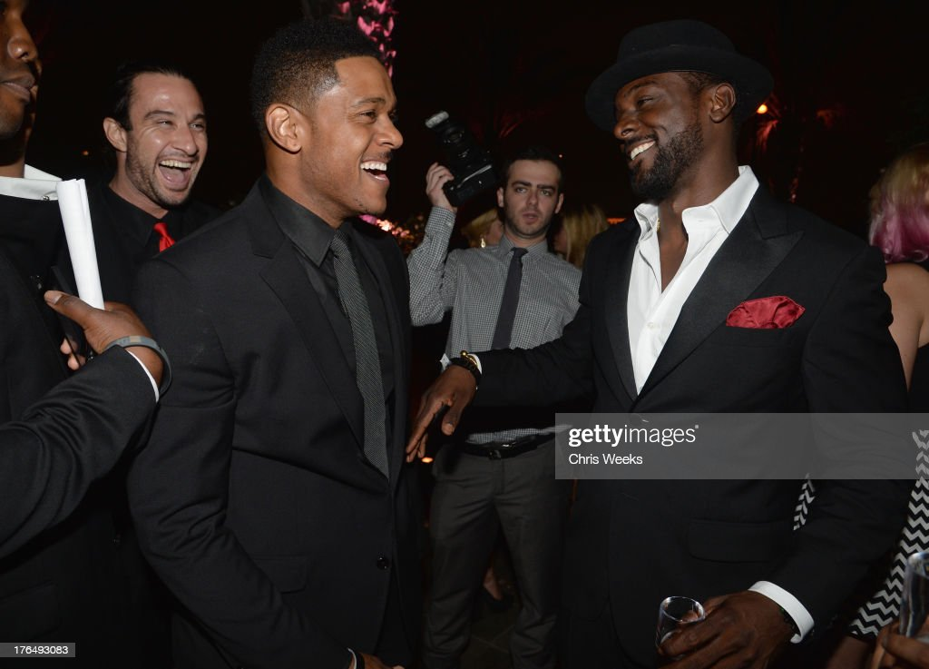 Actors Pooch Hall (L) and Lance Gross attend Moet Rose Lounge Los Angeles hosted by Big Sean at The London West Hollywood on August 13, 2013 in West Hollywood, California.