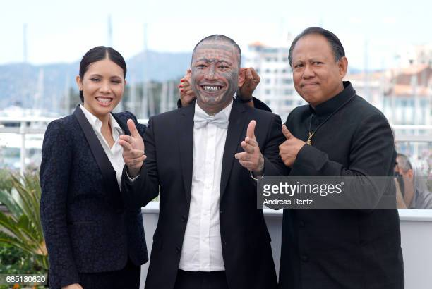 Actors Pornchanok Mabklang Panya Yimumphai and Vithaya Pansringarm attend the A Prayer Before Dawn photocall during the 70th annual Cannes Film...