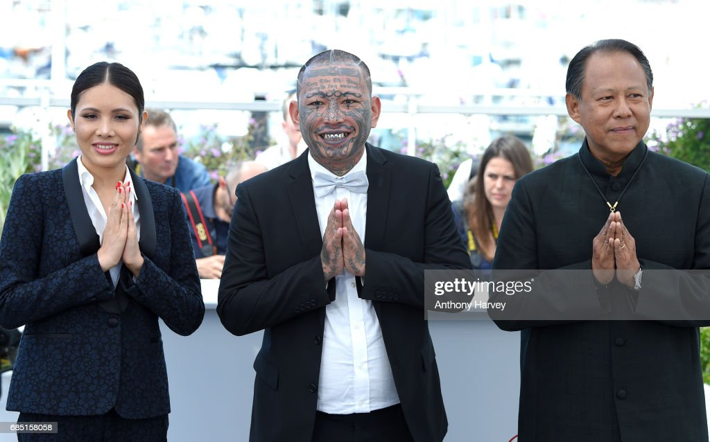 Actors Pornchanok Mabklang, Panya Yimumphai and Vithaya Pansringarm attend the 'A Prayer Before Dawn' Photocall during the 70th annual Cannes Film Festival at Palais des Festivals on May 19, 2017 in Cannes, France.