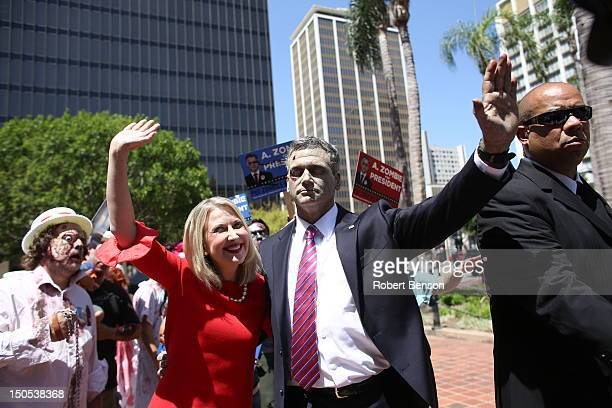 Actors portraying America's first zombie presidential candidate A Zombie and his wife Patty MorganZombie greet fans and other zombies at a press...