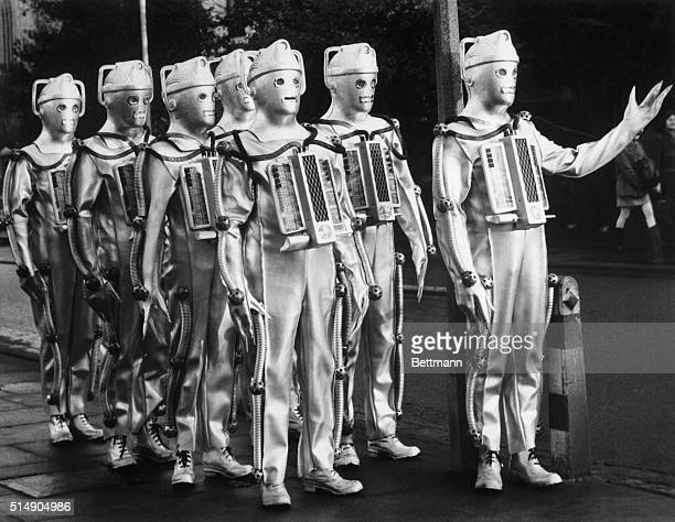 Actors portraying cybermen enemies of Dr Who in the BBC television show appear in London
