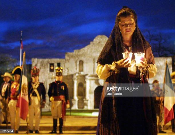 Actors portraying defenders of the Alamo hold a candle light vigil in front of the building during a reenactment of the fall of the Alamo March 6 to...