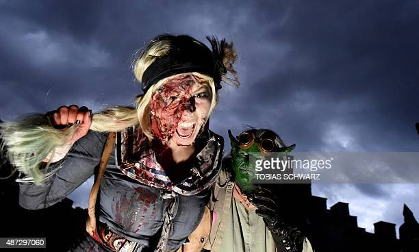 Actors pose during a casting of artists performing as monster for the upcoming socalled Horrornights event at the film park Babelsberg in Potsdam...