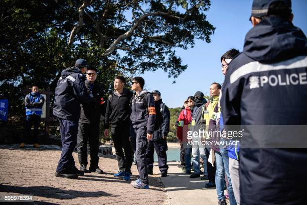 Actors posing as residents and tourists prepare to be evacuated off Tung Ping Chau island as part of an interdepartmental Daya Bay Contingency Plan...