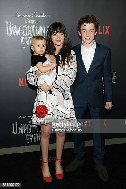 Actors Presley Smith Malina Weissman and Louis Hynes attend the Lemony Snicket's a Series of Unfortunate Events screening at AMC Lincoln Square...