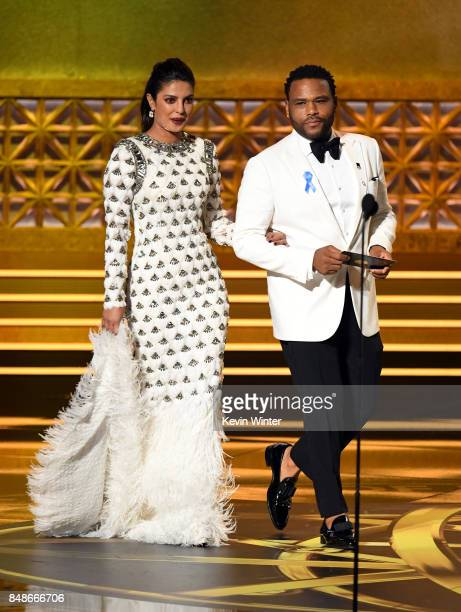 Actors Priyanka Chopra and Anthony Anderson walk onstage during the 69th Annual Primetime Emmy Awards at Microsoft Theater on September 17 2017 in...