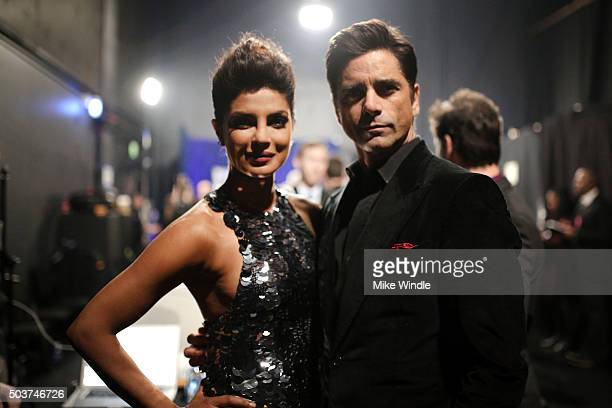 Actors Priyanka Chopra and John Stamos attend the People's Choice Awards 2016 at Microsoft Theater on January 6 2016 in Los Angeles California