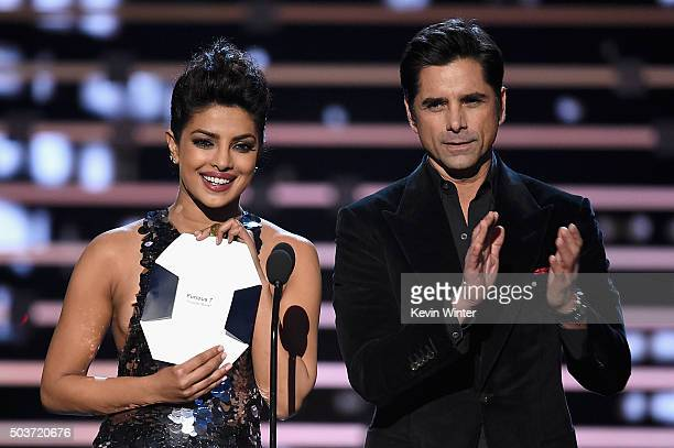 Actors Priyanka Chopra and John Stamos speak onstage during the People's Choice Awards 2016 at Microsoft Theater on January 6 2016 in Los Angeles...