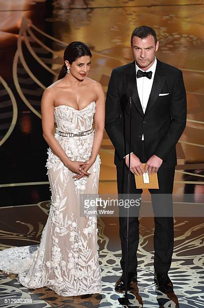 Actors Priyanka Chopra and Liev Schreiber speak onstage during the 88th Annual Academy Awards at the Dolby Theatre on February 28 2016 in Hollywood...