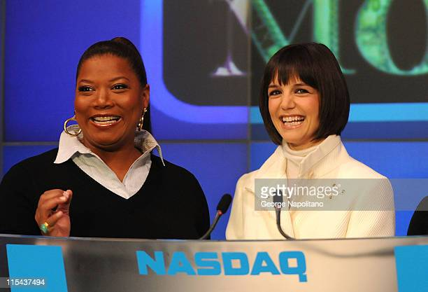 Actors Queen Latifah and Katie Holmes ring the opening bell at the NASDAQ Times Square on January 16 2007 in New York City