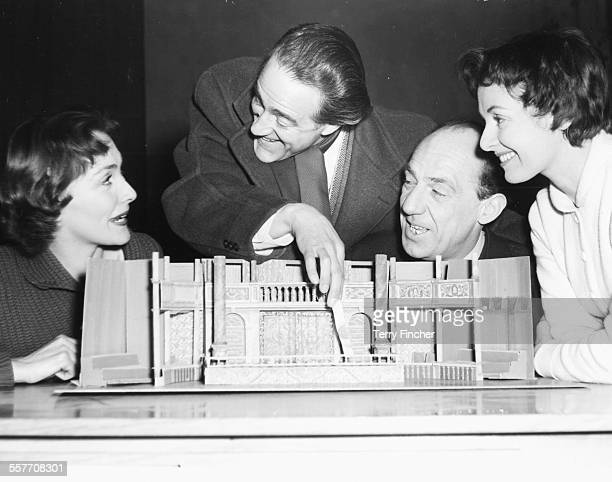 Actors Rachel Gurney Hal Burton Michael Hordern and Jane Wenham inspecting a model of the set for their next play circa 1955