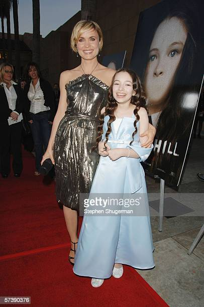 Actors Radha Mitchell and Jodelle Ferland attend the premiere of TriStar Pictures' Silent Hill at the Egyptian Theatre on April 20 2006 in Hollywood...