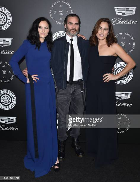 Actors Rain Phoenix Joaquin Phoenix and Summer Phoenix arrive at The Art of Elysium's 11th Annual Celebration Heaven at Barker Hangar on January 6...