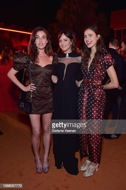 Actors Rainey Qualley Dakota Johnson wearing Gucci and Margaret Qualley attend 2018 LACMA Art Film Gala honoring Catherine Opie and Guillermo del...
