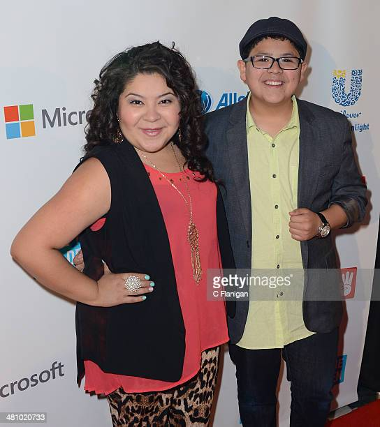 Actors Raini Rodriguez and brother Rico Rodriguez pose backstage during the 1st Annual 'We Day' California at ORACLE Arena on March 26 2014 in...